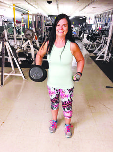 """<div class=""""source"""">Submitted photo</div><div class=""""image-desc"""">Forty-year-old Liz Hopkins, above, compares a weight from when she began her weight loss journey more than a year ago, right, with the weight she currently uses. Hopkins underwent back surgery in February 2017, and although her doctor said it couldn't be done, lost 100 pounds to reduce the risk of repeating the surgery. </div><div class=""""buy-pic""""><a href=""""/photo_select/17928"""">Buy this photo</a></div>"""
