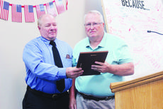 """<div class=""""source"""">Photo by Molly Haines/N-H Editor </div><div class=""""image-desc"""">Owenton Rotary Club President David Lilly presents Bob Cull with the Owen Countian of the Year award July 15.</div><div class=""""buy-pic""""><a href=""""/photo_select/18076"""">Buy this photo</a></div>"""