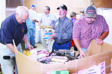"<div class=""source"">Photo by Brian Riddle/For The News-Herald </div><div class=""image-desc"">Bob Mills, Greg Cole and David Willoughby unpack a box at the First Christian Church Food Pantry's new location on West Perry Street Monday.</div><div class=""buy-pic""><a href=""/photo_select/17934"">Buy this photo</a></div>"