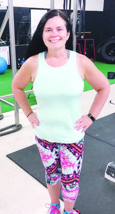 """<div class=""""source"""">Submitted photo </div><div class=""""image-desc"""">At 39 years old, Liz Hopkins went under the knife for back surgery. At approximately 250 pounds, her weight attributed to the need for the surgery. She stood a 96 percent chance of repeating the surgery if she failed to lose a significant amount of weight. Although doctors said it couldn't be done, Hopkins shed the weight in a little over a year and also shed the need for blood pressure medicine and various over-the-counter medicines aiding with daily aches and pains. This photo shows Hopkins 100 pounds lighter, June 1. </div><div class=""""buy-pic""""><a href=""""/photo_select/17930"""">Buy this photo</a></div>"""