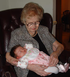 "<div class=""source"">Ernie Stamper</div><div class=""image-desc"">Mother, about two months before her death, holding her g-grandchild, Annelise</div><div class=""buy-pic""></div>"