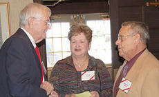 """<div class=""""source""""></div><div class=""""image-desc""""> Schirmer Riley, left, greets Judy and Bernie Poe as they arrive at the New Liberty reunion.</div><div class=""""buy-pic""""><a href=""""/photo_select/41"""">Buy this photo</a></div>"""