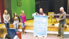 """<div class=""""source"""">Photo courtesy of David Lilly/Owenton Rotary Club</div><div class=""""image-desc"""">Owenton Rotary Club member and Owen County High School Principal Duane Kline, center, unveils the Interact Club banner to a group of students at OCHS while Owenton Rotary President Jeff Davis, right, look on. </div><div class=""""buy-pic""""><a href=""""/photo_select/17621"""">Buy this photo</a></div>"""