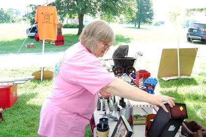 Donna Linker browses through a booth set up at Lighthouse Church.