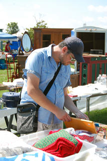 Dany Hanny, from Normandy, France, browses through one of the booths at the 127 yard sale. Hanny was visiting with friends from the Cincinnati area.