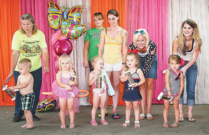 The winners of the baby pageant 24-36 months were (from left to right): Overall Boy, Nathaniel Miller; Prettiest Eyes, Hallie Ruth Tirey; Friendliest, Sarissa Bowman; Biggest Smile, Aurora Wilhoite; Overall Girl, Payton Buchanan.