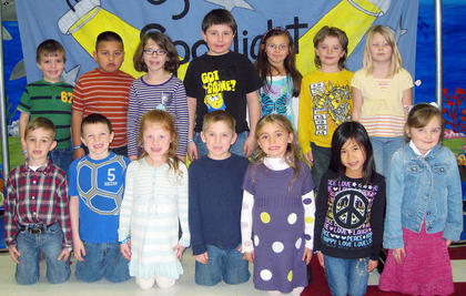First Grade November and December PAWS-itive Citizens of the Month Award Winners