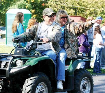 News-Herald columnist Dana Burke and Ramon Chism wave to friends and neighbors during the parade.