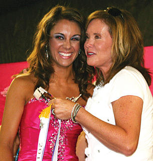 Danielle Hoop gets a hug from Teena Gamble, the mother of Miss Owen County Fair 2011 Madison Gamble. Madison could not attend this year's pageant to hand over the crown, but sent a letter by her parents, Teena and Kelley Gamble, thanking Owen County after her year-long reign.