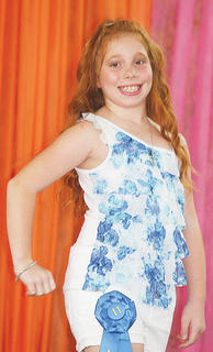 Madalyn Wright participated in the Miss Preteen pageant.
