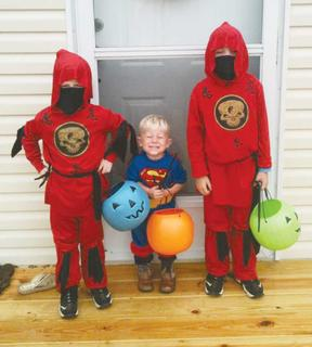 Alex Young as a ninja, Levi Young as Superman and Ethan Young as a ninja.
