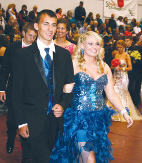 Dalton Sons and Olivia Karsner stop to smile for the camera at Saturday's Owen County High School grand march.