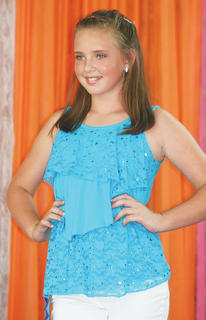 Paige Heuser participated in the Miss Preteen pageant.