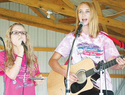 Ashley Smith and Julie Spaulding sing a special song for cancer survivors.