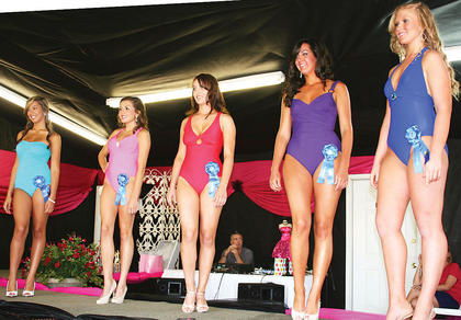 Tyera Lancaster, Jenna Harris, Stephanie Sons, Molly Borchers and Kayla Maddox show off their swimwear.