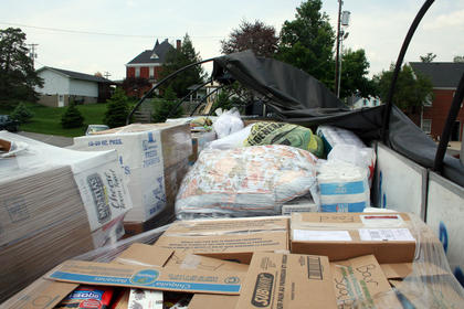 As the donations from Owen County poured in, the back of Danny Cook's tractor-trailer quickly filled.
