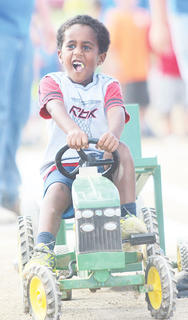 Micah David enjoyed the pedal pull during Family Fun Night at this year's Owen County 4-H Fair and Horse Show.