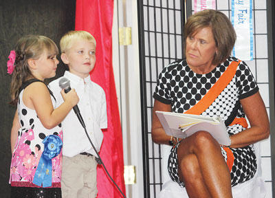 Owen County Upper and Lower Elementary Principal Sharen Hubbard chats with contestants Madelyn Justis and Conner Dezarn.