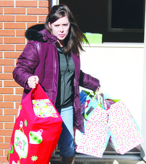 Ginny Miller packs gifts out of the News-Herald office to be taken to the Owen County Extension Office for children on the Angel Tree.