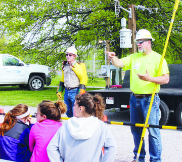 Doug Criswell and Tony Dempsey talk with students about safety around electric lines.