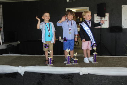 The winners of the 2017 Little Prince Owen County Fair were (from left to right): second run- ner up, Toby Fitzgerald; first runner up and people's choice, Kayden Lusby and Little Prince winner Austin Bourne.