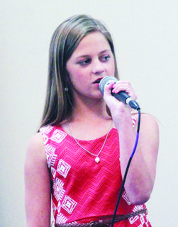 Makenzie Risch performs special music during Sunday's service.