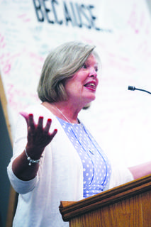 Beth Perkins, wife of Ken Perkins and a native of Owen County, gives Sunday's testimony.
