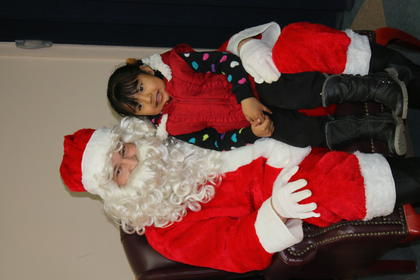 Ashley Perez poses for a photo with Santa.