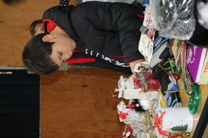Devin Taylor looks through a gift table.