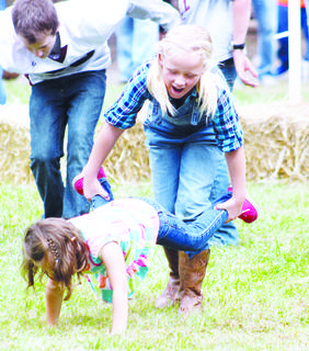 Delaney Tabor and Emileigh Stivers participate in the Monterey Fair field games.