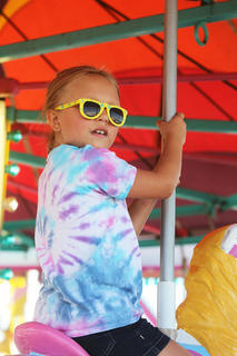 Liberty Abrams, 6, catches a ride on the Merry-Go-Round.