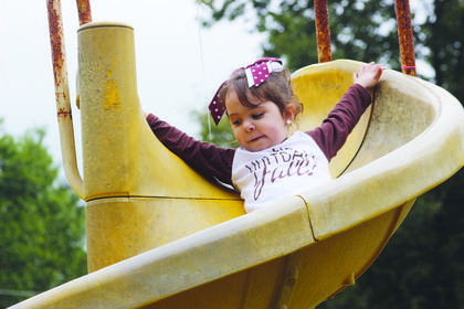 Maci Ray goes for a slide in the Monterey Park.