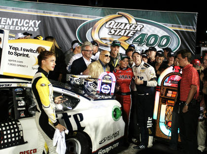 Brad Keselowski poses for a photo with Speedway Motorsports Incorporated Chairman Bruton Smith. SMI owns the Kentucky Speedway and several other racetracks that host NASCAR races.