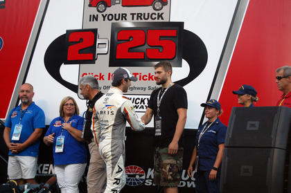 Williams shakes hands with Daniel Suarez, who qualified in first place for Thursday's truck race.