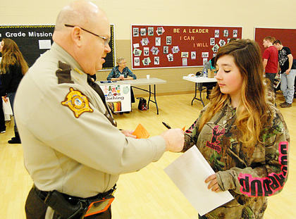Owen County Sheriff Mark Bess gives Sarah Beach a ticket for speeding.