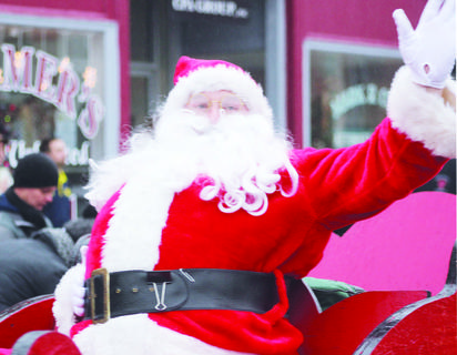 Santa Claus waves to the crowd of parade goers.