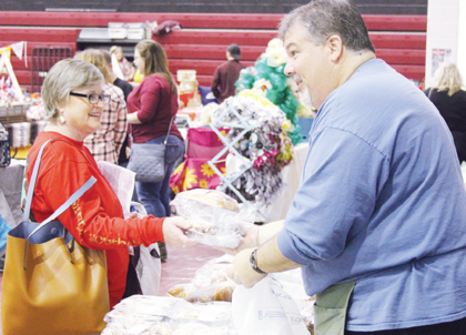 Scott Johnson, right, bags baked goods for Karen Wotier.