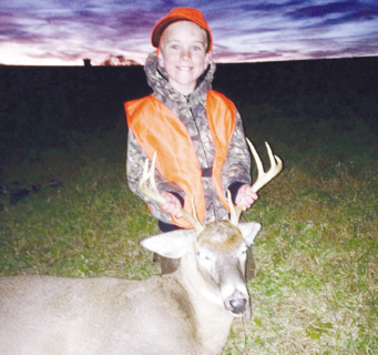 Trace Duvall, 7, shot his first deer, an 8-point buck.