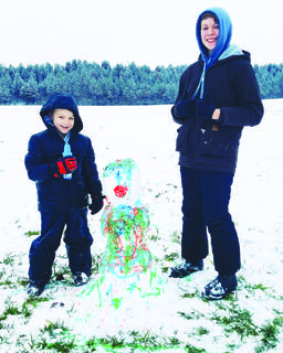 Cameron and Ryder Bond of Sparta creating a colorful snowman.