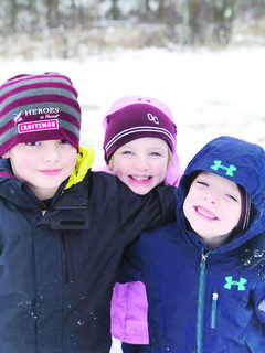 Dawson, Addison and Kason Locke pose for a photo in the snow.