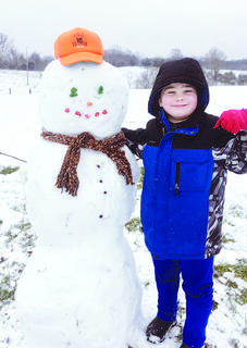 Kenneth Widener woke up bright and early to build this snowman, topping him off with a deer hunter hat.