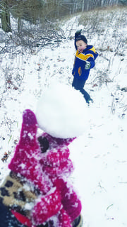 Micah Moore enjoys a snowball fight during Winter Storm Gia's visit to Owen County.