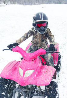 Brantley Peters enjoys a ride on his 4-wheeler in the snow Jan. 12.