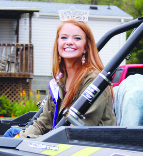 Miss Owen County Veronica Chisholm rides in the Monterey Fair parade.